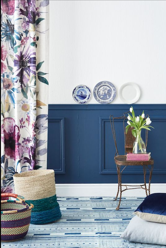 By Simone Borcherding stylist   writer   spacemaker. Navy panelled wall chair rail, Tricia Guild fabric curtain, wire chair, woven baskets, tulips and Delft plates.