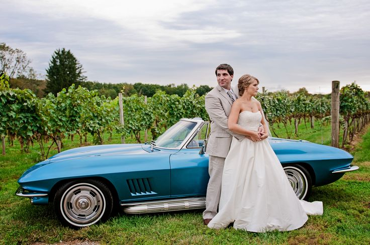 bride and groom by retro car at winery wedding