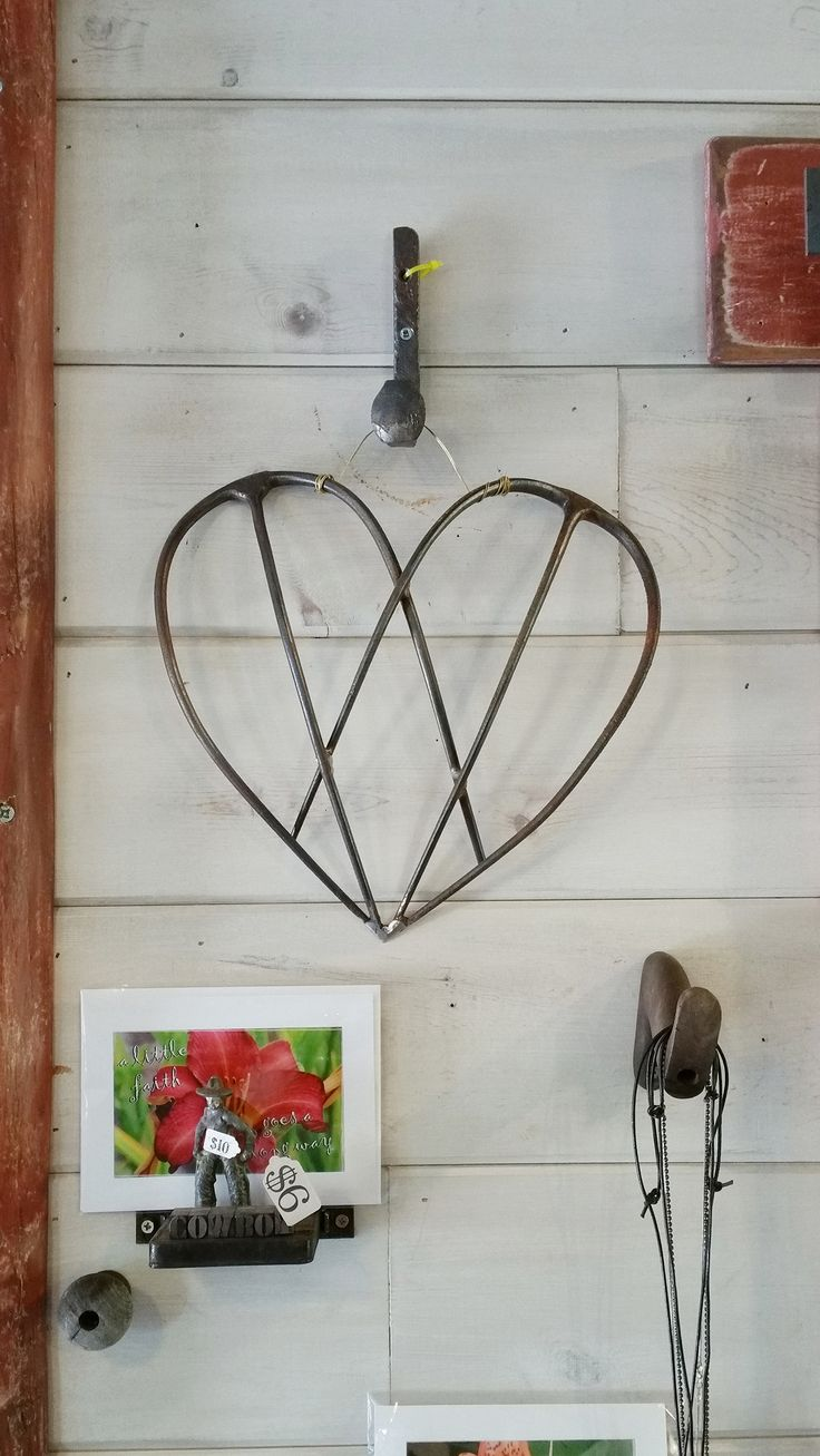 Ever notice when you put two pitchforks together it forms a perfectly beautiful heart - or butterfly wings - or fairy wings?  Here's the proof!  Thanks to my customer James for the welding job on this one.  Pitchfork heart, repurposed pitchfork, repurposed farm junk, pitchfork angel wings