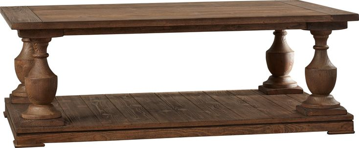 Crafted from fir wood and featuring a smoked barn finish, this rustic console table adds lodge-chic appeal to your living room or home library.