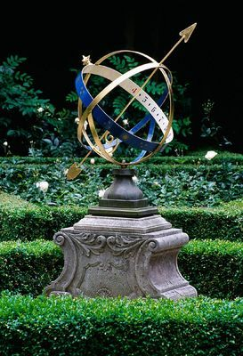 Armillary sphere in an Amsterdam private knot garden - photo by Clive Nichols
