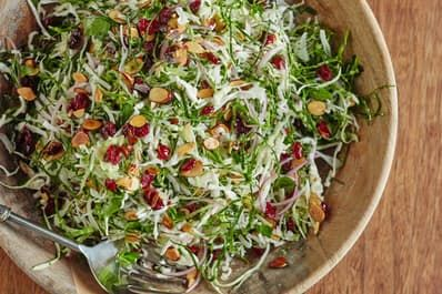 The idea of serving salad at Thanksgiving is, in theory, a good one — you want something light, crunchy, and refreshing to balance out the roast turkey and rich sides. The reality, however, is that most salads need to be tossed at the last second and eaten quickly before wilting — not the best choice when there's a lot going on in the kitchen already and the food might sit out for a few hours. This easy, colorful slaw is the answer to this dilemma. It won't wilt like other green salads and…