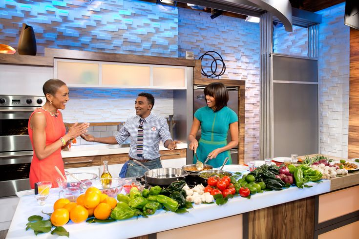 """First Lady Michelle Obama, """"Good Morning America"""" anchor Robin Roberts, and chef Marcus Samuelsson participate in a cooking segment at the GMA Studios in New York, N.Y., Feb. 22, 2013. (Official White House Photo by Chuck Kennedy) This official White House photograph is being made availa"""