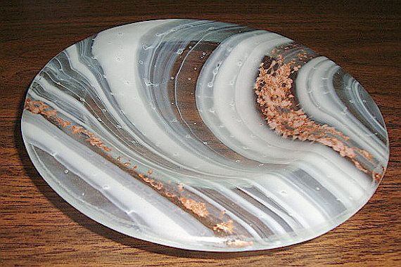 """This small dish/bowl is created using a layer of clear glass and a layer of """"baroque"""" white swirl glass . The copper color between the layers is"""