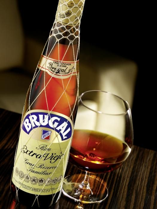 Brugal: Dominican Rum aged in whiskey barrels..DRANK A LOT OF THIS STUFF in Puntan Cana!!!  YUM, YUM!