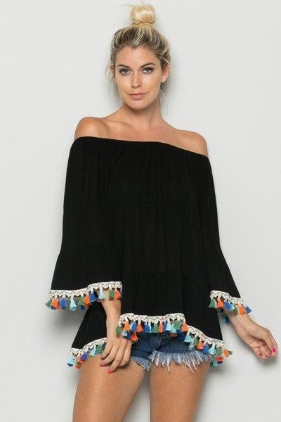 Show off your colorful spirit in this ah-dorable off-shoulder blouse. This seemingly ordinary black strapless knit top is accented with a beautiful array of