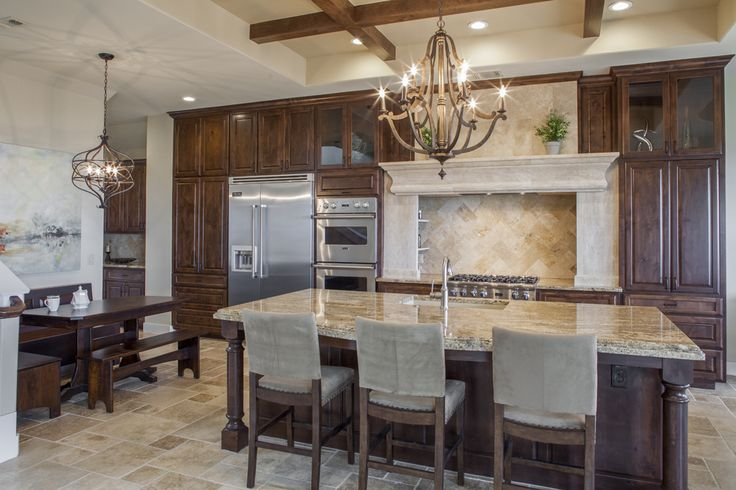 gorgeous granite- aurus premium. knotty alder cabinets stained at