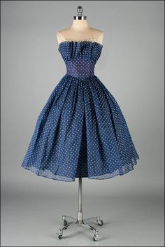 Love the polka dots with the mesh layering. It adds volume and sophistication to the dress.