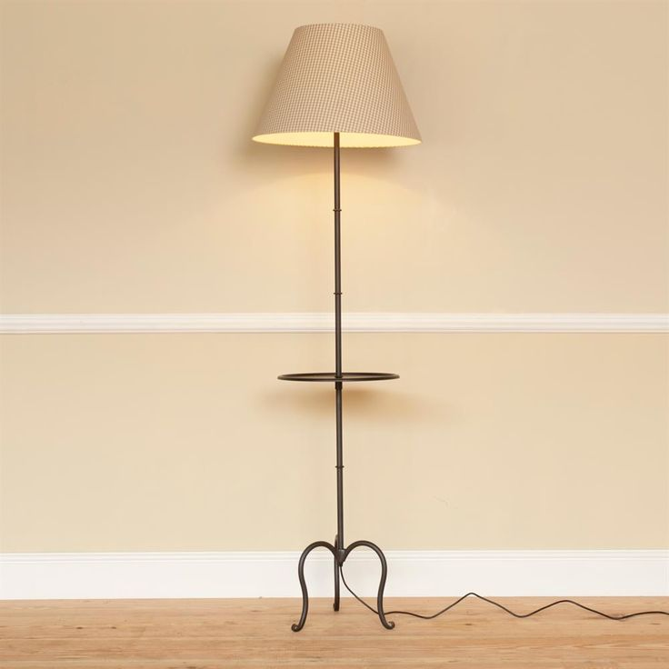A hand #forged #steel #floor #lamp. It has a dual purpose of #lighting up those #corners and providing a handy surface.