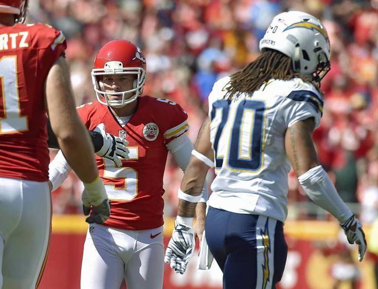 Kansas City Chiefs place kicker Cairo Santos is congratulated after tying the…