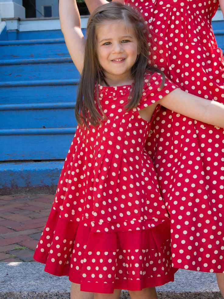 Hip hop polka dot! Cute as a button, the Elly girls dress is an adorable version of the Ellen dress for adults. A solid red hemline and a solid red fabric band in the middle of the skirt are nice details to take note of on a style that is as lovely as it is comfortable.