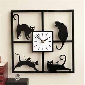 siluetas de gatos con reloj