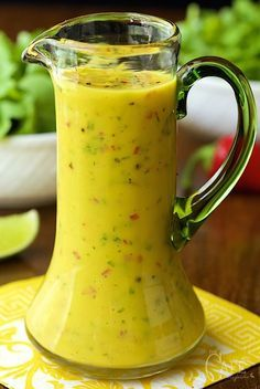 Sweet and Spicy Mango Salad Dressing - so delicious, super easy and the anecdote for boring salads! Oh, and it's fabulous drizzled over pan-seared or grilled salmon, shrimp or chicken too!