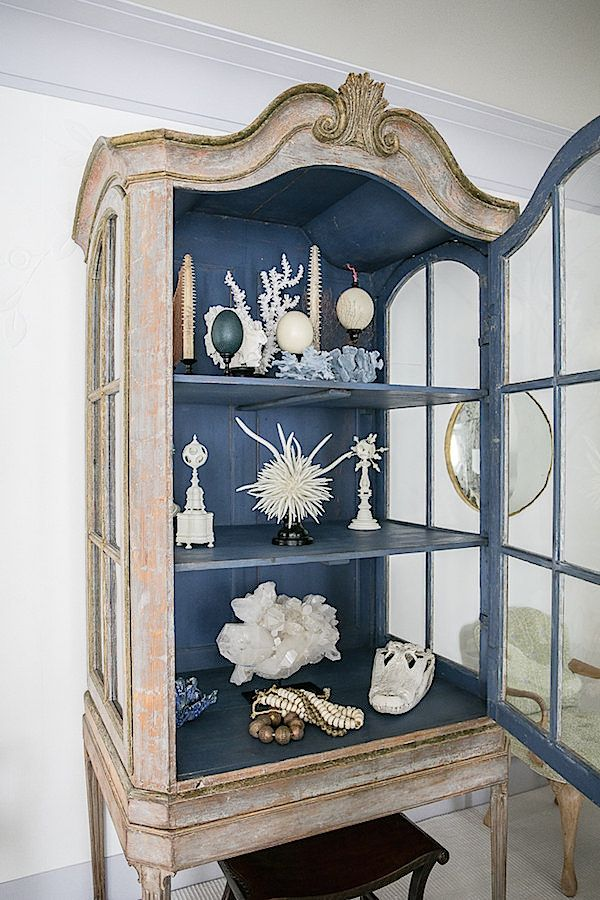 cabinet in Timothy Whealon Kips Bay Show House White Orchard Room. mid-18th century vitrine with dark blue inside filled with organic accessories