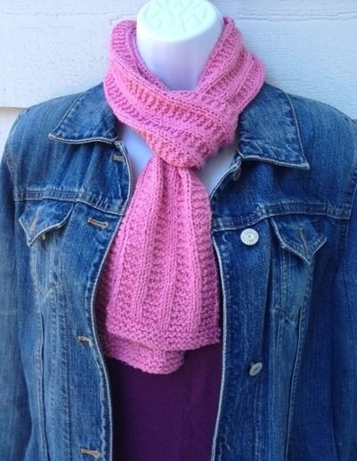 Pretty knitted pink scarf in garter rib pattern. Uses knit ...