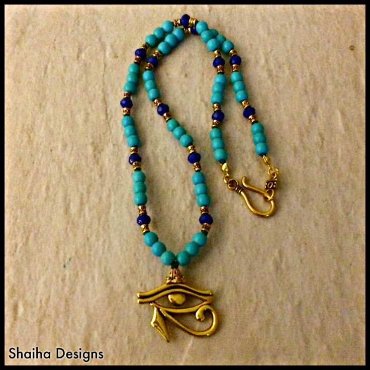 "The+Wedjoyet+is+an+ancient+Egyptian+symbol+of+power,+protection+and+good+health.++This+lovely+necklace+also+features+turquoise+magnesite+beads+which+helps+with+aligning+your+needs+with+your+heart's+desires.+Finished+with+a+lead-free+golden+hook+clasp,+it+is+20""+long."
