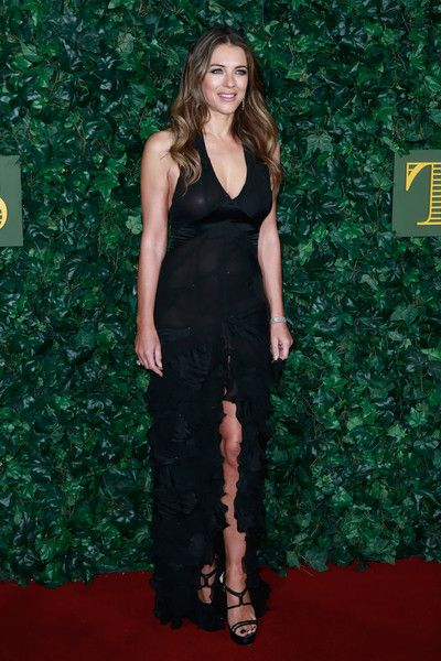 Elizabeth Hurley Evening Dress - Elizabeth Hurley looked ravishing in a semi-sheer black gown with a plunging neckline and a high front slit at the London Evening Standard Theatre Awards.