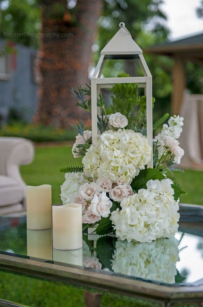Lantern centerpiece with ivory hydrangea blush spray