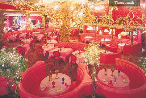 1970s bar & restaurant in pink, gold, & red with round booths at The Madonna Inn