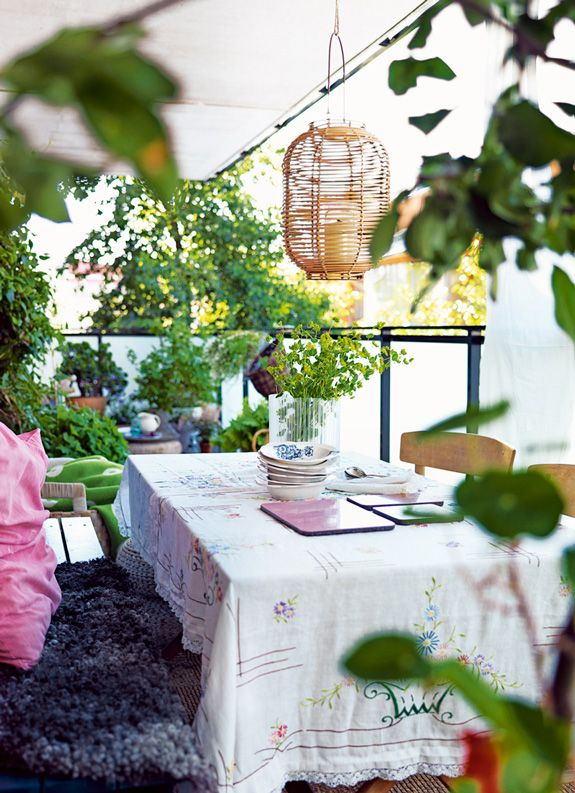 belle maison: Cozy Outdoor Living for Small Spaces, greenery, table cloth, pillows and fuzzy type seating, tented courtyard area