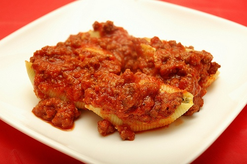 Cheese & spinach stuffed pasta shells with meat sauce