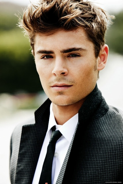 "Zach Effron - my 7 year old daughter had posters of him on her wall... After watching""The Lucky One"".. His posters may end up on MY wall!! Omg!"