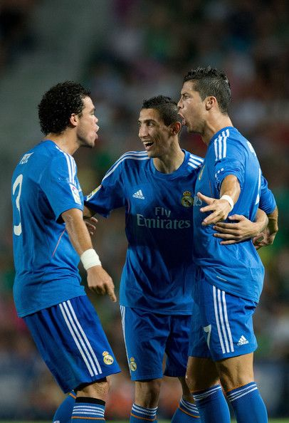 Cristiano Ronaldo and Angel Di Maria Photos Photos - Cristiano Ronaldo (R) of Real Madrid CF celebrates scoring their opening goal with teammates Pepe (L) and Angel Di Maria (2ndR)  during the La Liga match between Elche FC and Real Madrid CF at Estadio Manuel Martinez Valero on September 25, 2013 in Elche, Spain. - Elche FC v  Real Madrid CF
