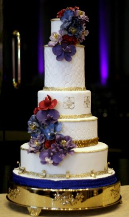 Red and purple orchid wedding cake