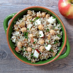 A warm quinoa salad with apples, walnuts and chickpeas that's lovely for Thanksgiving.