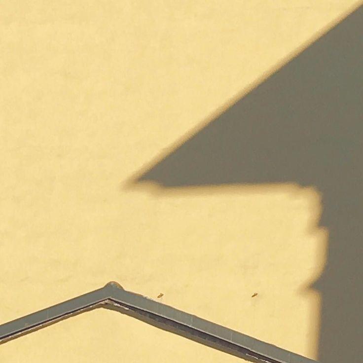 Shadow with triangle on yellow #rsa_minimal #minimalmood #minimalporn #lookingup #photooftheday #igersmilano #igerslombardia #igersitalia