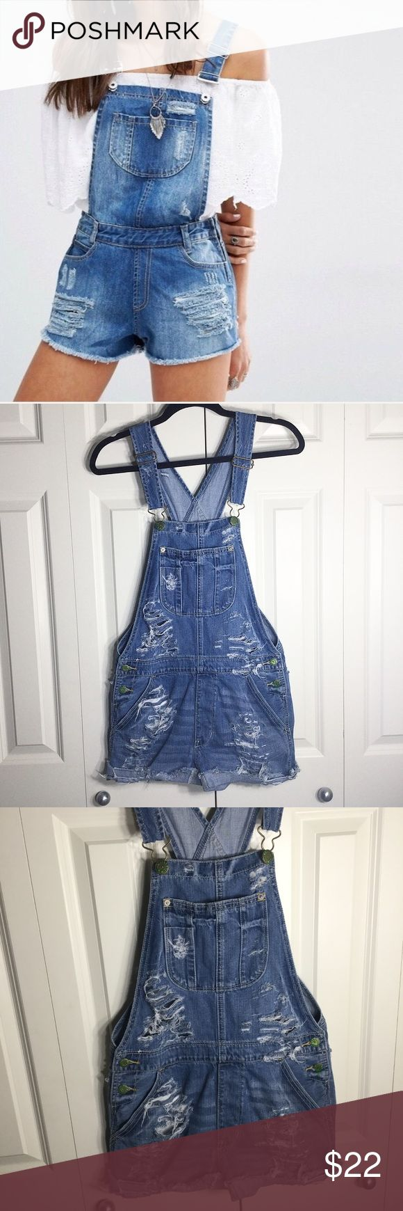 ❣️AEO   Distressed Short Denim Overalls❣️ •American Eagle Outfitters heavily distressed short denim overalls   •size XS •in new condition; with the exception of the handmade distressed look  IG: @notyourhamper 📸 Same day shipping!📆 Pet/smoke free home!🚭 Offers encouraged!💸 Bundle & save!🛍  Thanks for looking, xo💋 American Eagle Outfitters Jeans Overalls