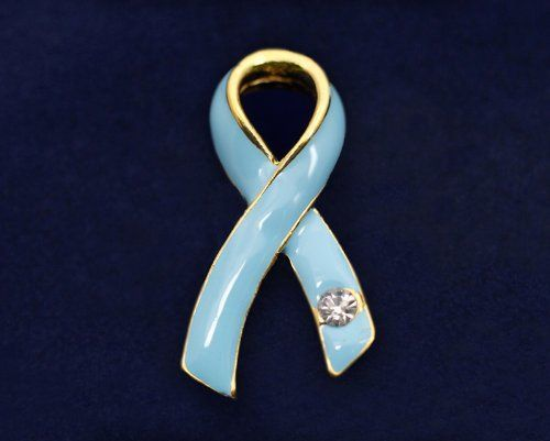 Light Blue Ribbon Pin- Large w/Crystal (Retail) by Fundraising For A Cause. $12.00. This pretty pin is a light blue ribbon layered in gold. Pin is 1 1/2 inches tall by 3/4 inch wide. Each light blue ribbon pin comes in a box with cotton insert.