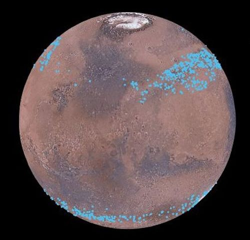 Mars distinct polar ice caps, but Mars also has belts of glaciers at its central latitudes – between the blue lines, in both the southern and northern hemispheres. A thick layer of dust covers the glaciers, so they appear as the surface of the ground, but radar measurements show that there are glaciers composed of frozen water underneath the dust. Credit: Mars Digital Image Model, NASA/Nanna Karlsson
