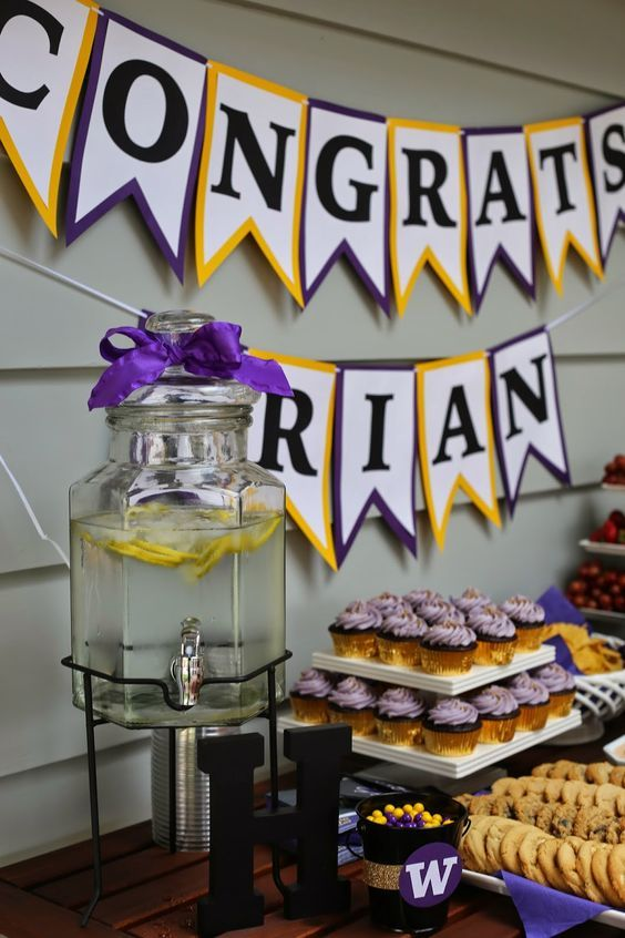 Graduation party food table in gold and purple school colors
