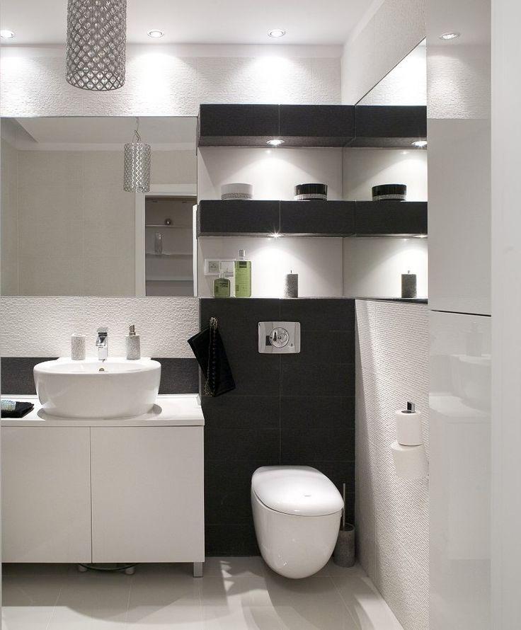 Aranżacja łazienki jest elegancka i stonowana. Mała łazienka, czarno-biała, nie jest zimna ...