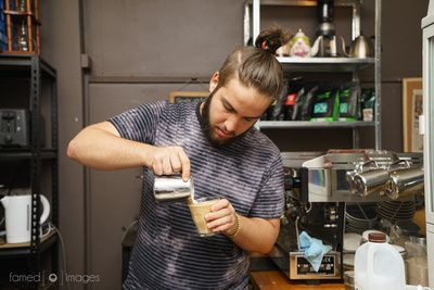 Mr Jacob Denaro pouring a coffee at Cup From Above