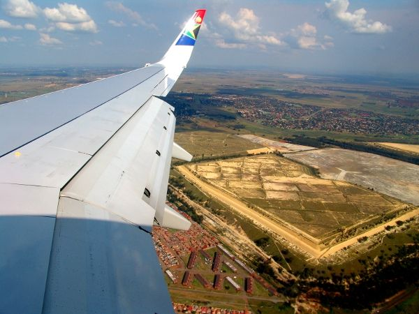 Mine dump & treatment facility of the East Rand Proprietary mine, seen below the wing of the SAA plane coming in to land at OR Tambo International Airport