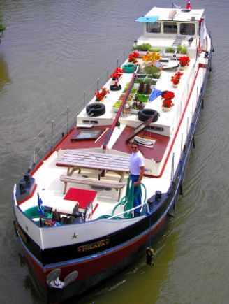 So cool. River barges in Europe. It's like Europe's version of a houseboat.