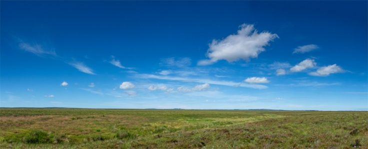 Munsary Peatlands Reserve, Caithness, Scotland, with scattered fair-weather cumulus clouds.
