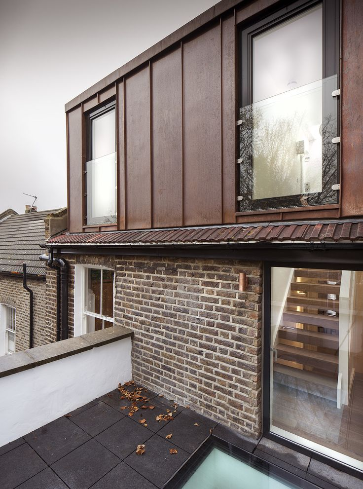 Exterior view - copper clad dormer, glass balustrades, terrace access and original victorian window frame