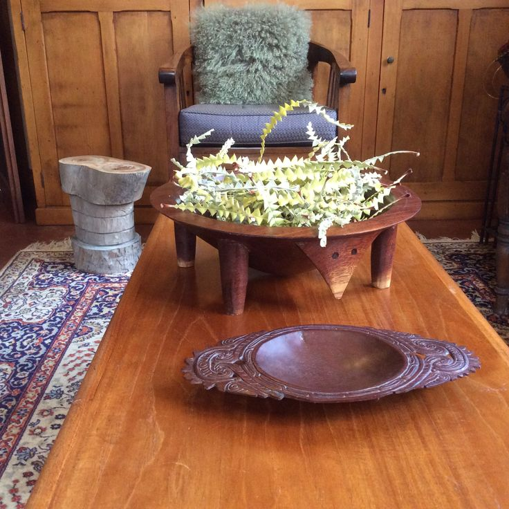Coffee table : thrifted tribal artefacts , dried banksia leaf floral arrangement. Mid century Fler coffee table. Small stool hand carved by clever husband from camphor laurel tree. (Felled, as a noxious weed.)