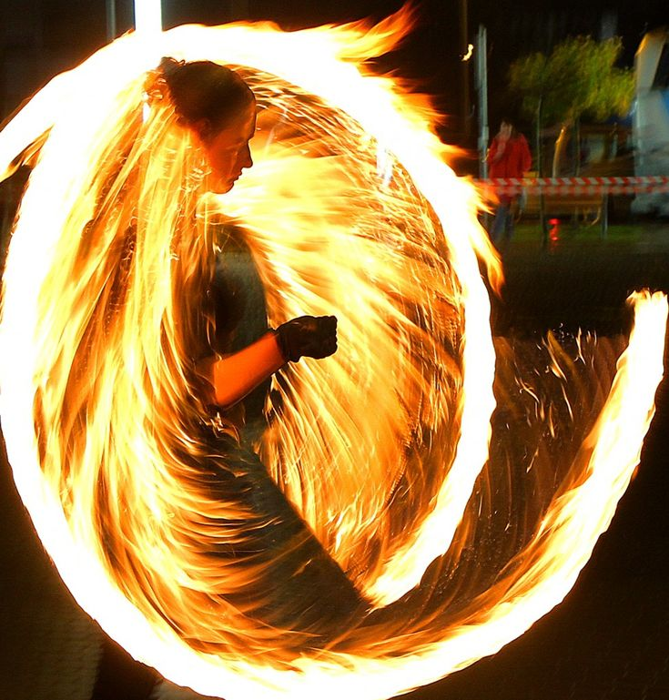 A member of the Fire Dance Group performs a choreography with torches in the streets of Vilnius, Lithuania. (AFP)