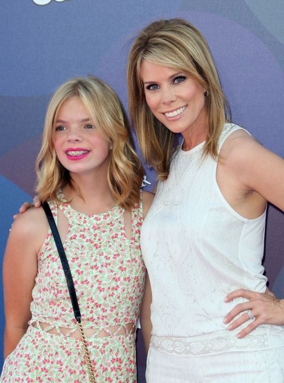 """Actress Cheryl Hines (R) and daughter Catherine Rose Young attend the premiere of Disney-Pixar's """"Inside Out"""" at the El Capitan Theatre on June 8, 2015 in Hollywood, California.  (Photo by David Livingston/Getty Images)"""