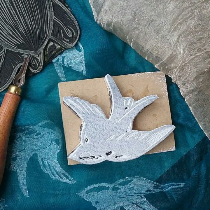 Here is one of the block-print swallows inked up here in white for a scarf print,  it's the same swallow used on the hemp make-up bag. Carved once; many purposes.