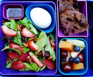 Mixed green salad with strawberries and pecans, balsamic and lime vinaigrette, hard boiled egg, raisin walnut bread, fruit salad