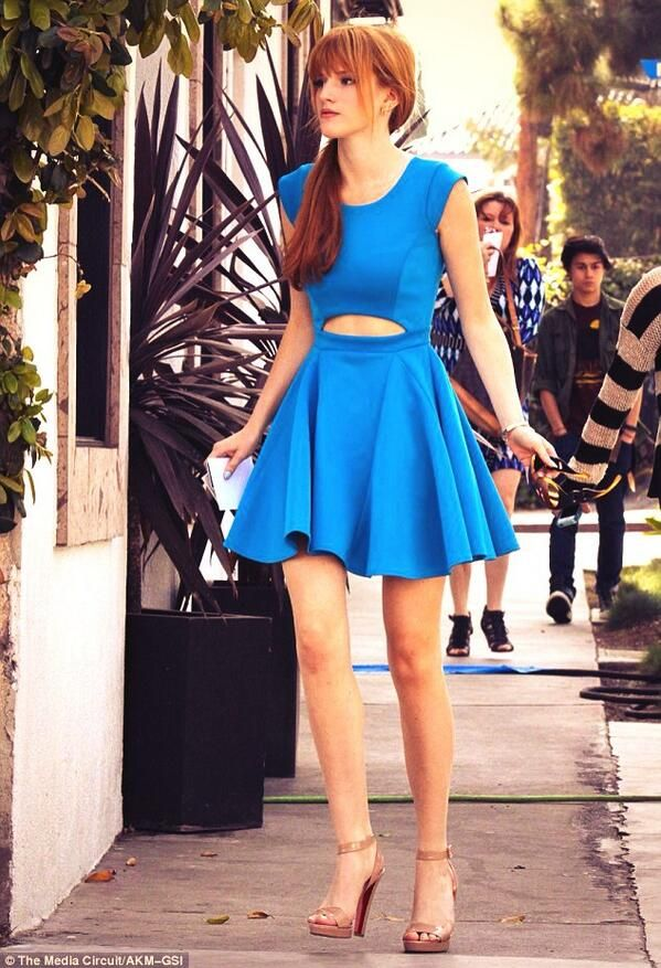 Love Bella Thorne's strappy nude heels, white clutch, bright blue dress and side pony