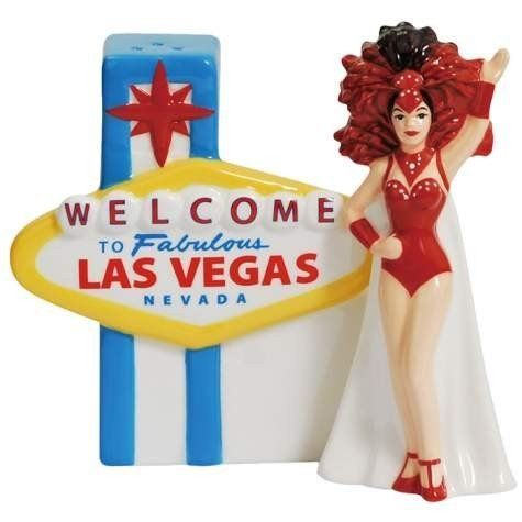 """Westland Giftware Welcome to Las Vegas Salt and Pepper Shakers by Westberry Wellness Programs. $12.00. Exceptional Quality. Bright and cheery. Wonderful gift. Made of ceramic material. These fun """"Mwah."""" salt and pepper shakers feature a """"Welcome to Vegas"""" sign and Vegas showgirl, and they are even magnetic so that they always stay together. These are a great addition to any table. Westland Giftware is known for quality and design."""
