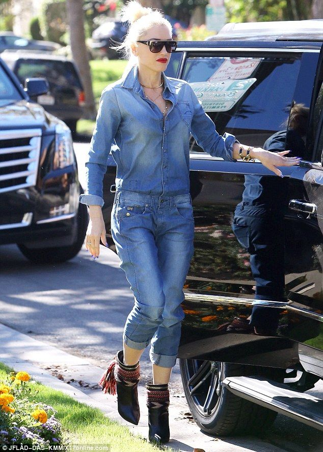 Mom life: Gwen Stefani rocked a denim jumpsuit for church with her family on Sunday in Los Angeles