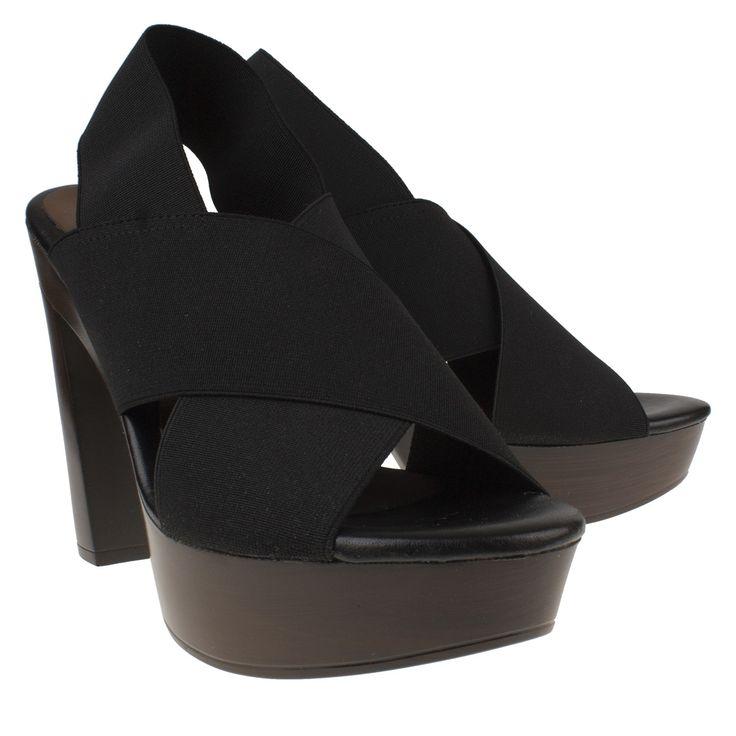Rapisardi ILA zwart sandaal hak met elastiek  Sandalette van het merk Rapisardi model ILA nero. Deze zwarte hakken zijn vervaardigd van imitatieleer en hebben een trendy stevige hak gemaakt van kunstof. Deze sandaal op hoge hak is voorzien van elastische kruisbanden over de wreef en achter de hiel wat zorgt voor goede aansluiting van de voet. Dankzij het hoge plateau onder de voorvoet zijn deze hakken comfortabel om op te lopen. Deze Rapisardi sandalettes zijn voorzien van een voetbed van…