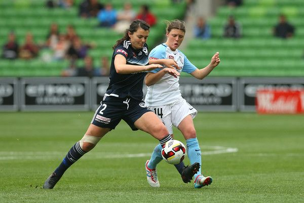 Alexandra Natoli of Melbourne Victory (L) and Melina Ayres of Melbourne City compete for the ball during the round four A-League match between Melbourne City FC and Melbourne Victory at AAMI Park on November 27, 2016 in Melbourne, Australia.